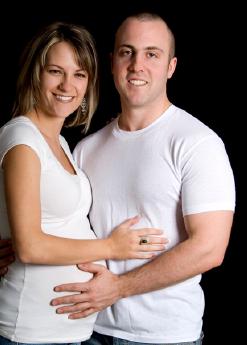 smiling pregnant couple